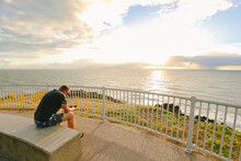 Digital Nomad Man Working On Phone During Early Morning Walk At The Lambert's Beach Lookout In Mackay, Queensland Australia