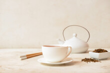 Cup Of Tasty Hojicha Green Tea On Light Background