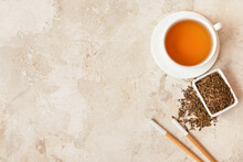 Composition With Dry Hojicha Green Tea On Light Background