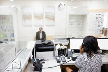 Receptionist And Patient In Optometry Center