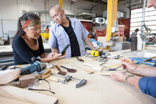 Woodworkers Making Wooden Spoons In Workshop