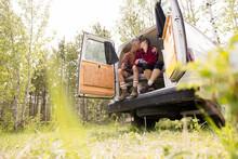 Couple Kissing In Doorway Of Camper Van