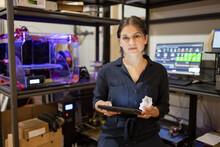 Portrait Confident Female Maker With Digital Tablet At 3D Printer