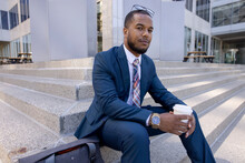 Portrait Confident Handsome Businessman With Coffee On City Steps