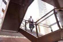 Businesswoman Descending City Steps