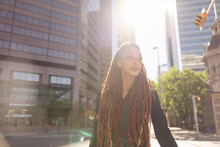Beautiful Young Woman With Long Hair In Sunny City