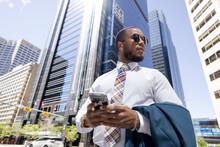 Stylish Businessman Using Smart Phone In City