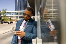 Stylish Businessman Using Smart Phone In Sunny City