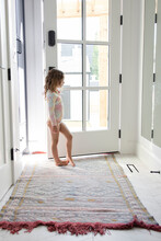 Girl Standing At Front Door