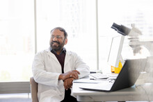 Smiling Male Scientist In Lab Coat Working In Laboratory
