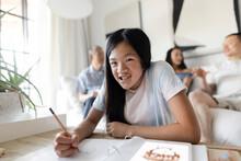 Portrait Happy Girl Coloring In Living Room