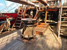 Wooden Windlass And Various Rigging On The Main Deck Of An Old Wooden Sailboat