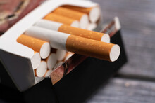 A Pack Of Cigarettes On The Table.