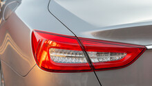 The Red Headlight Of A Modern Sedan Metallic Car. Rear Stop Light. Premium LED Sedan Taillights