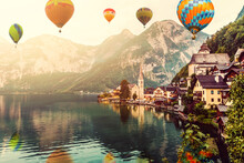 Colorful Hot Air Balloons Flying Over The Lake Surrounded By Mountains. Large Multi-colored Balloons Slowly Rising Against Blue Sky. Travel, Adventure, Festival.