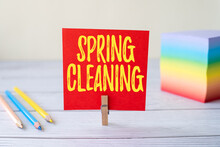 Conceptual Display Spring Cleaning. Concept Meaning Thorough Cleaning Of A House Or Room During Spring Blank Sticky Note Laundry Clip Stack Of Colorful Paper Pen Placed On Desk.