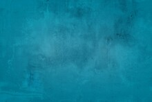Old Blue Wall In Spots, Cracks, Stains. Painted Concrete Wall In Abstract Grunge Style Loft. Vintage Wall Background Texture For Backgrounds, Portraits, Posters.