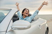 Happy European Girl Celebrating In Cabriolet Car