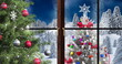 Image of winter scenery landscape seen through window and decorated christmas tree on blue backg