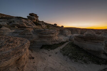 Sunrise Over Rock Hoodoos At Writing On Stone Provincial Park In Alberta, Canada