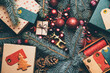 Top view Christmas gifts, on wooden background with copy space.