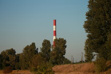 Industrial Chimney Behind The Trees