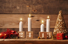Fourth Advent, Four Candles Burning On A Rustic Wooden Table With Christmas Decoration