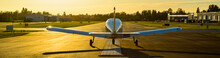 Small Plane Ready To Take Off At Sunrise.