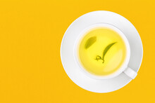 Cup Of Green Oolong Tea Over Yellow