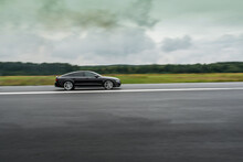 Side View Of A High Performance Luxury Car In Motion