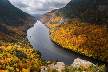 A Hiker Overlooking Lower Ausable Lake In New York's Adirondack Mountains.