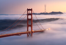 A Classic Scene, With Very Low Fog Flowing Undernearh The Golden Gate Bridge, California