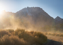 A Cloud Of Dust Creates Exciting Light In The Backroads Of The Eastern Sierra, California