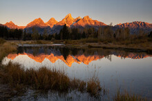 The Teton Mountains, Glowing With Warm Sunrise Light, Reflected In The Calm Waters Of Schwabacher Landing. Grand Teton National Park, Wyoming