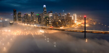 A Rare Evening Patch Of Valley Fog Drifts Into Downtown San Francisco, California