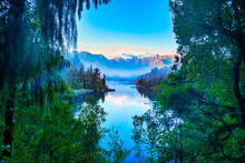 Lake Matheson Is One Of The Most Photographed Lakes In The World Famous For Its Reflections Of The Snow Covered Southern Alps