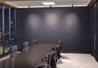 Leinwandbild Motiv Blank wall Mockup in dark modern office with windows and spotlights. Empty company meeting room 3D rendering