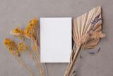 Fototapeta Kawa jest smaczna - Bohemian blank invitation card surrounded by natural dried palm leaf and grasses. Wedding and celebration background