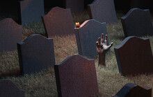Zombie Hand Coming Out Of A Graveyard