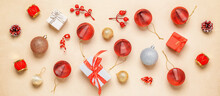 Beautiful Christmas Composition. Christmas Banner With Red Christmas Balls, Gift Boxes And Decorations On A Beige Grunge Background. Top View, Flat Lay.