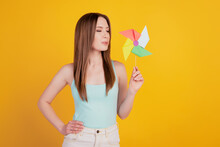Portrait Of Tender Tempting Lady Hold Toy Propeller Blow Air Kiss On Yellow Background