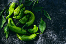 Fresh Green Peppers With Leaves