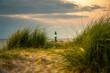 canvas print picture - golden light during sunset on old lighthouse Warnemünde