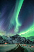 Aurora Borealis, Northern Lights Explosion Over Mountain On Winter At Flakstad, Lofoten Islands
