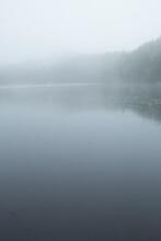 Fog And Mist Enshroud Lake Solitude In Newbury, New Hampshire.
