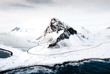 Eystrahorn Mountain In The Eastfjords Of Iceland,covered By Snow  Near The Beach And Sea In The Winter, Photo From Drone