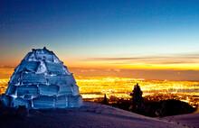 Igloo On Mountain Summit Above City Lights Of Vancouver, Canada.
