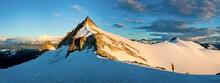 Panoramic View Of Mountain Climber Approaching Rock Mountain Summit