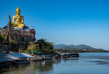 Golden Buddha Statue Over The Mekong River In The Golden Triangle
