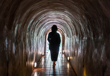 Woman Walking Through The Tunnel's Of The Temple Wat Umong